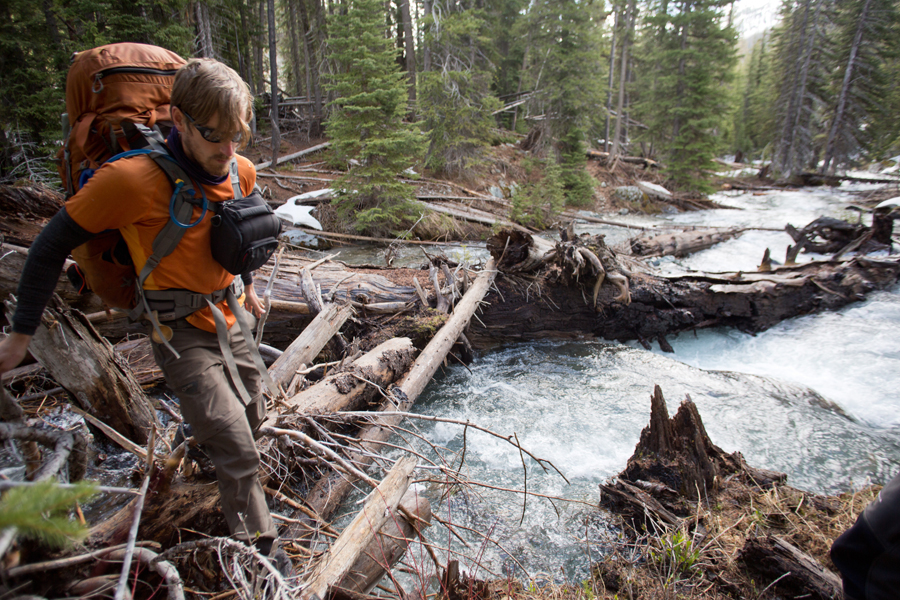 Jay Simpson crossing the upper Imnaha river on a log jam.