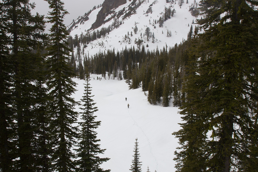 Dave and Galeo walking across the ice-covered Crater Lake of the Eagle Cap Wilderness.